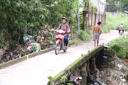 Mưa lớn cuốn trôi một thanh niên ở TP Biên Hòa - 1