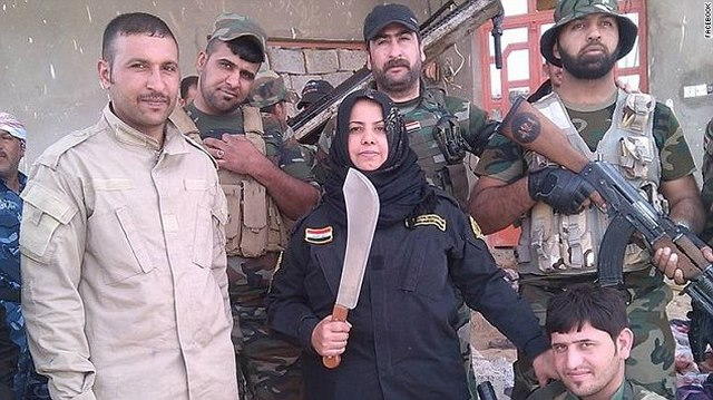 Góa phụ chuyên chặt đầu, thiêu xác khủng bố IS ở Iraq - 1