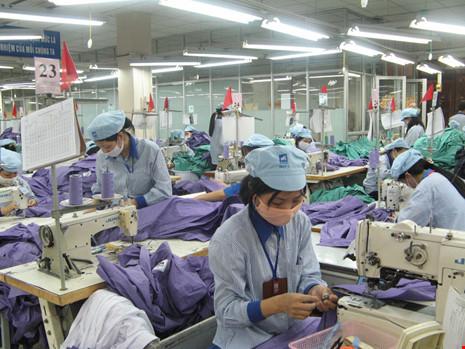 Lương lao động dệt may Việt Nam bằng một nửa Malaysia - 1