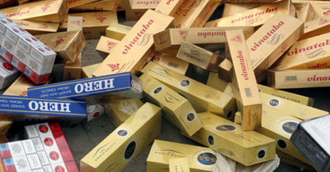 Bộ Tài chính đề xuất thí điểm xuất khẩu thuốc lá ngoại nhập lậu - 1