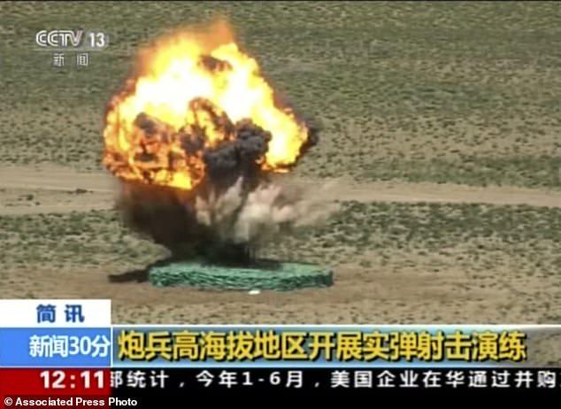 Sau lời dọa Ấn Độ, TQ rầm rộ tập trận bắn đạn thật thị uy - 2