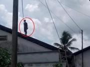 An ninh Xã hội - Thanh niên nghi ngáo đá, cố thủ 8 tiếng trên nóc nhà