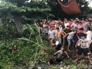 Clip: Dân vây đánh 2 thanh niên nghi trộm chó trốn dưới kênh nước