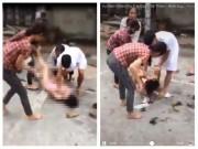 Cô gái bị xé váy, cắt tóc  xin tha  cho nhóm đánh ghen