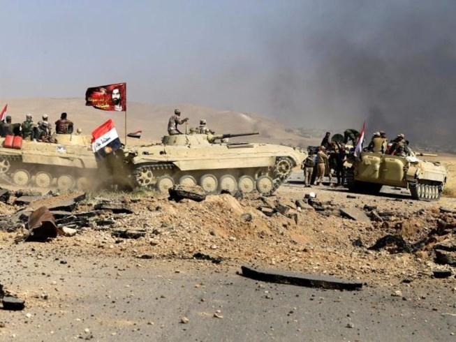Iraq giam giữ 1.400 vợ con của quân IS - 1