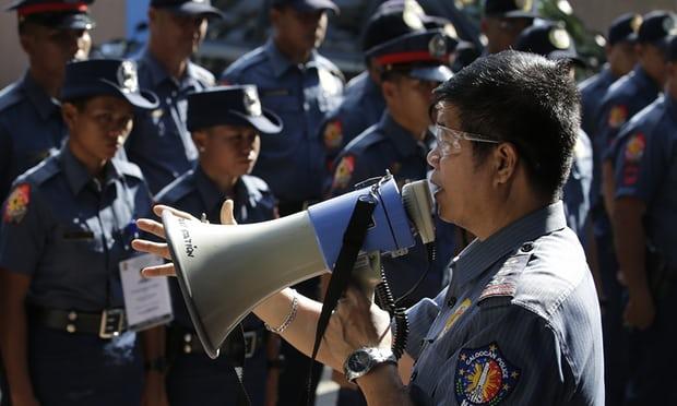 1.200 cảnh sát Philippines bị sa thải vì bê bối giết người - 1