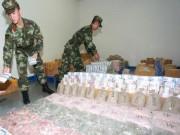 Sốc khi phát hiện 4 tấn tiền của 38 quốc gia ở nhà kho TQ