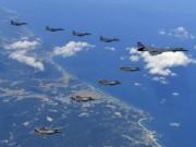 Thế giới - Hành động lạ của Triều Tiên sau lời dọa bắn rơi máy bay Mỹ