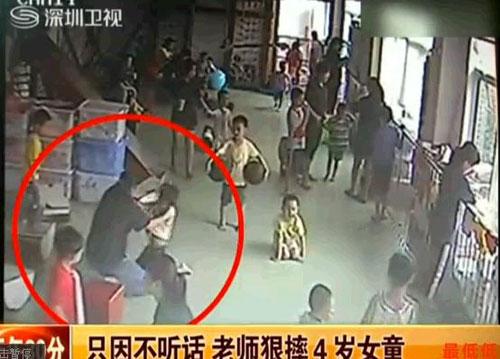 TQ: Cô giáo quăng trẻ mầm non xuống nền nhà - 1