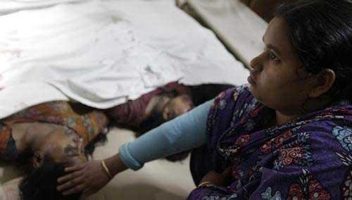 Cháy xưởng may ở Bangladesh: Hơn 120 người chết - 7
