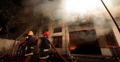 Cháy xưởng may ở Bangladesh: Hơn 120 người chết - 5