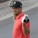 Thể thao - Tiger Woods đánh golf... xuyên 2 lục địa