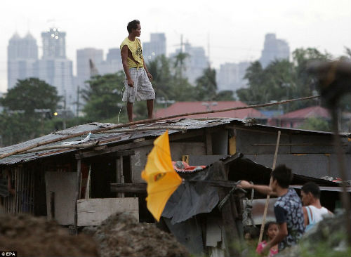 Tang thương vì siêu bão thế kỷ tại Philippines - 17