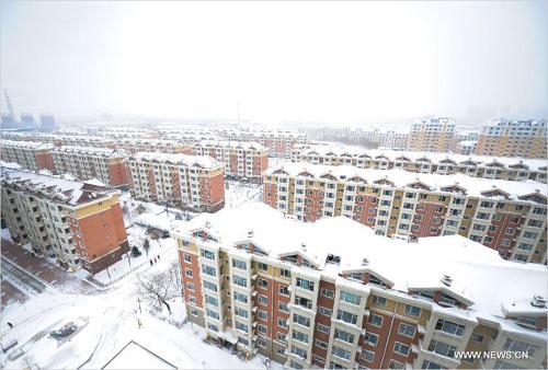 Ảnh: Bão tuyết hoành hành ở TQ, 4 người chết - 8
