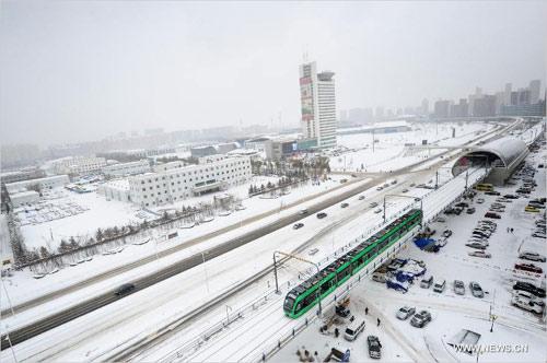 Ảnh: Bão tuyết hoành hành ở TQ, 4 người chết - 10