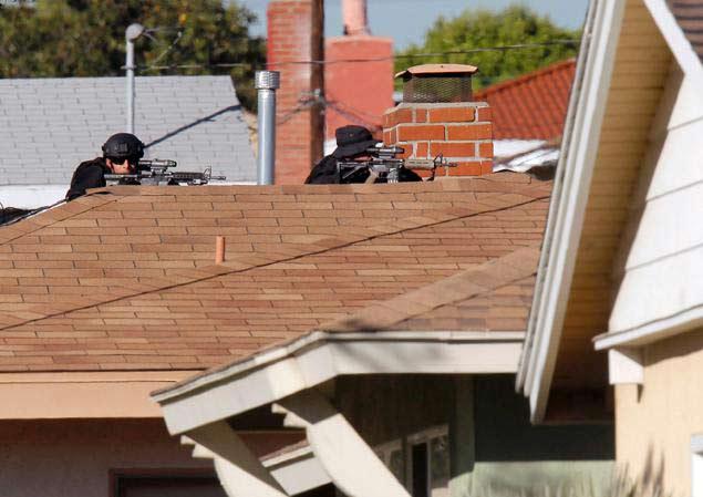 Mỹ: Bắt con tin, đấu súng cảnh sát suốt 9 giờ - 2
