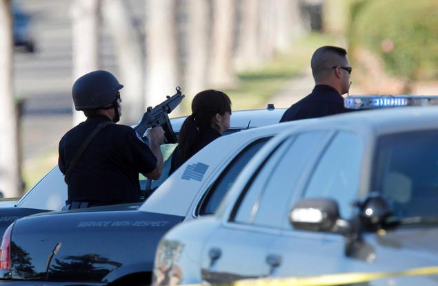 Mỹ: Bắt con tin, đấu súng cảnh sát suốt 9 giờ - 1
