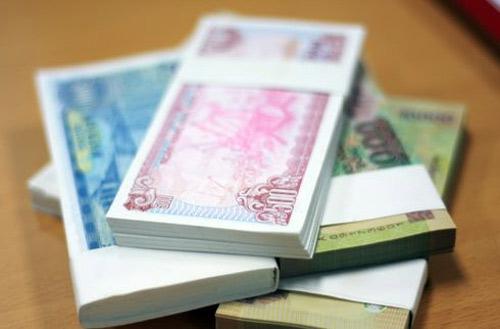 NHNN hạn chế in tiền lẻ mới dịp Tết 2014 - 1