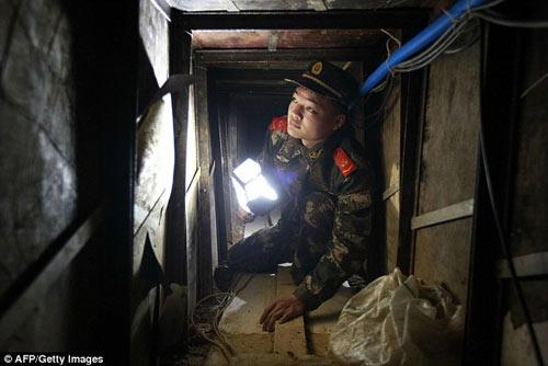 Phát hiện đường hầm buôn lậu tinh vi ở TQ - 3