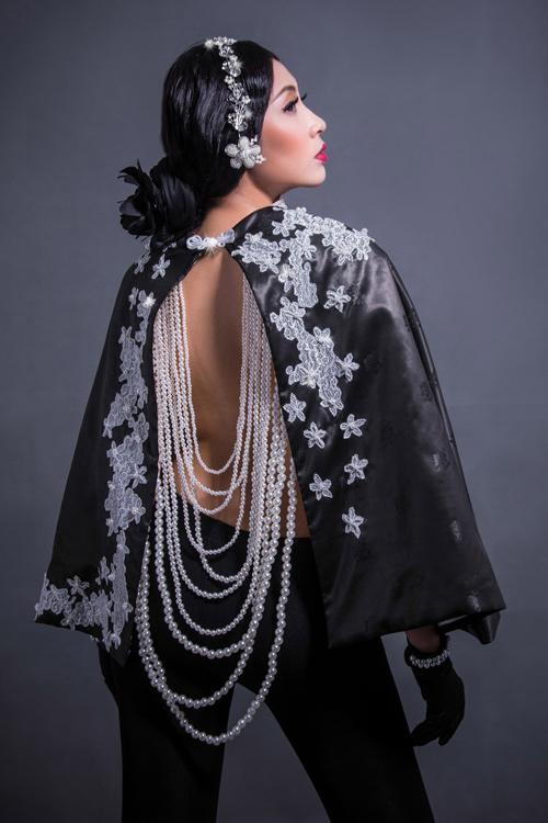 Hoa hậu Thu Thảo che ngực trần bằng hạt trai - 9