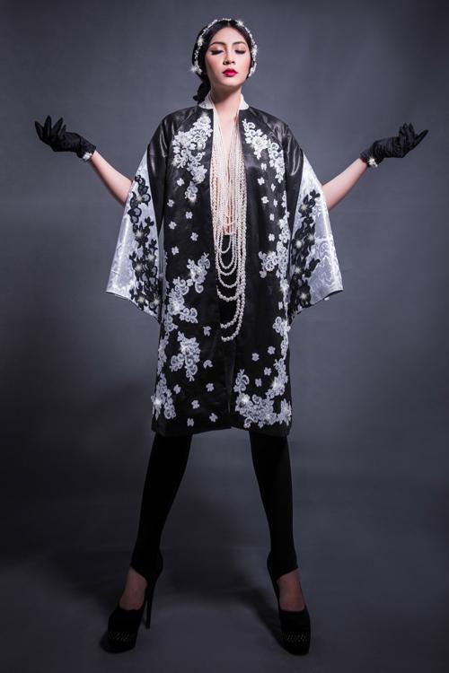 Hoa hậu Thu Thảo che ngực trần bằng hạt trai - 2