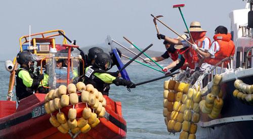 Cảnh sát biển Hàn Quốc bắn chết ngư dân TQ trên biển - 1