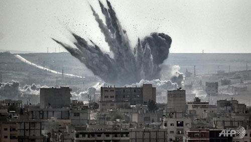 Bị oanh kích dữ dội,  IS vẫn không mất một tấc đất - 1