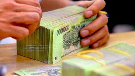 Bộ Tài chính đã vay xong 30.000 tỷ từ NHNN - 1