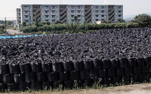 Ảnh: Bên trong vùng cấm nhà máy điện hạt nhân Fukushima - 11