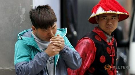 """1/3 đàn ông Trung Quốc có nguy cơ """"chết trẻ"""" - 1"""