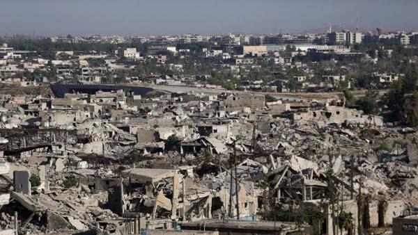 Ảnh: Cảnh thanh bình hiếm hoi trong đổ nát ở thủ đô Syria - 7