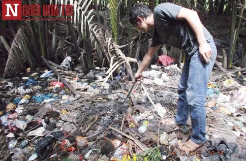 Trần tình của bà mẹ đốt xác con sơ sinh ở bãi rác - 2