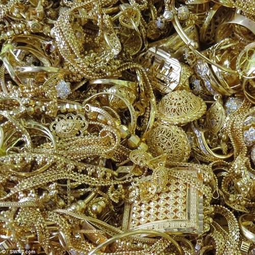 Đấu giá 150 kg vàng buôn lậu được định giá 82,5 tỉ đồng - 1