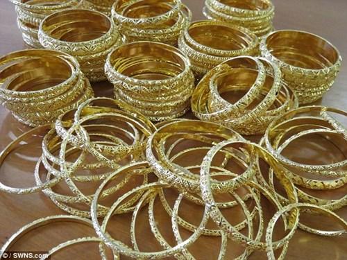 Đấu giá 150 kg vàng buôn lậu được định giá 82,5 tỉ đồng - 6