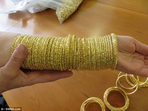 Đấu giá 150 kg vàng buôn lậu được định giá 82,5 tỉ đồng - 7