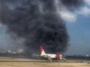 Thế giới - Mỹ: Máy bay chở 101 người bốc cháy trên đường băng