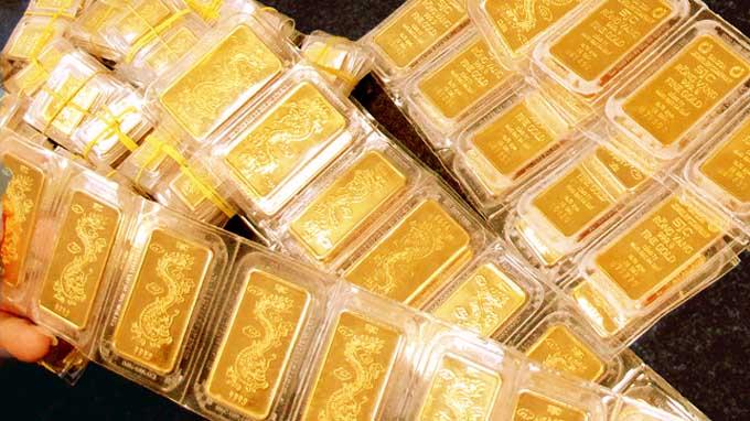 Giá vàng thế giới liên tục đi xuống trong 4 phiên - 1