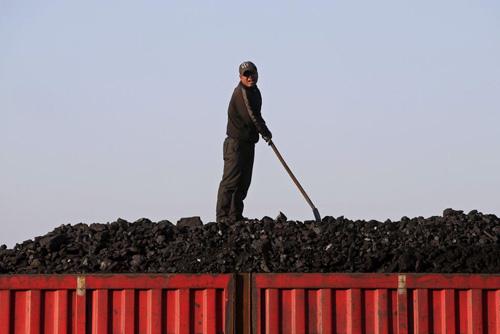 Ảnh: Cuộc sống bên trong thành phố mỏ ở Trung Quốc - 1