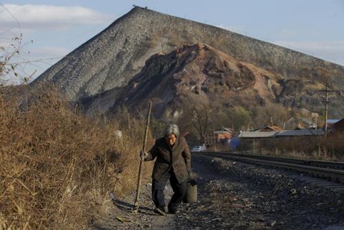 Ảnh: Cuộc sống bên trong thành phố mỏ ở Trung Quốc - 3