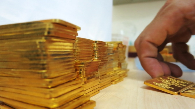 Vàng tăng giá dè dặt - 1