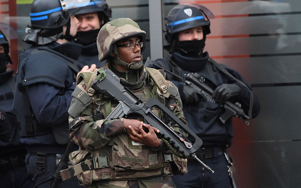 Cảnh sát đấu súng một mất một còn với khủng bố Paris - 6
