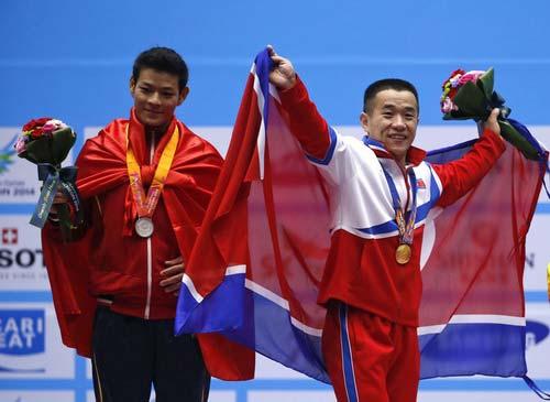 Thạch Kim Tuấn giành HCĐ cử tạ thế giới - 3