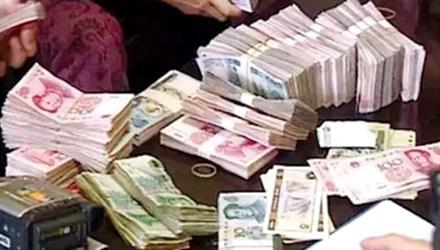 Trung Quốc triệt phá các ngân hàng rửa tiền - 1