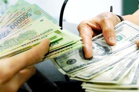 Tiền đồng Việt Nam vẫn lên giá và chịu áp lực - 1