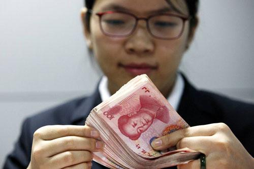 """Bắc Kinh """"kiểm tra sức chịu đựng"""" của thị trường tiền tệ - 1"""