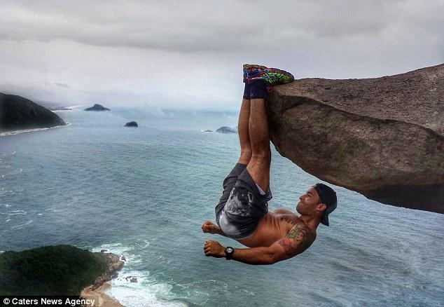 """Sự thật ngã ngửa về bức ảnh chàng trai """"đu trên vách đá"""" - 1"""