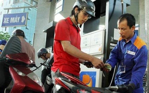 Giá xăng có thể giảm thêm do FED tăng lãi suất - 1