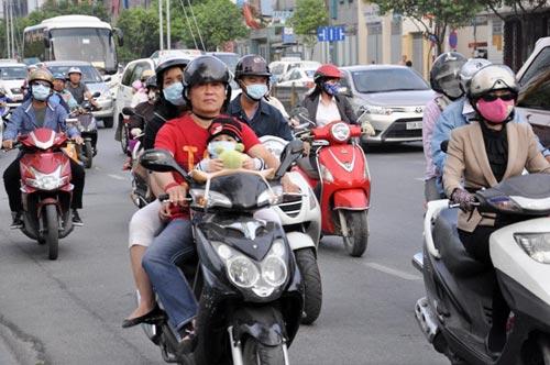 Sài Gòn se lạnh, người dân mặc áo ấm ra đường - 10