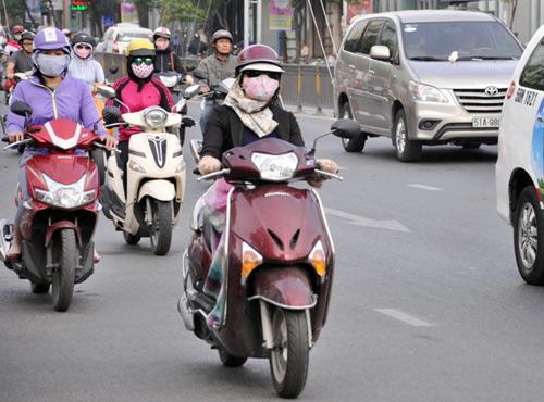 Sài Gòn se lạnh, người dân mặc áo ấm ra đường - 5