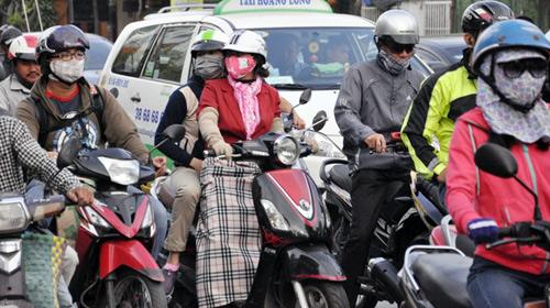 Sài Gòn se lạnh, người dân mặc áo ấm ra đường - 6